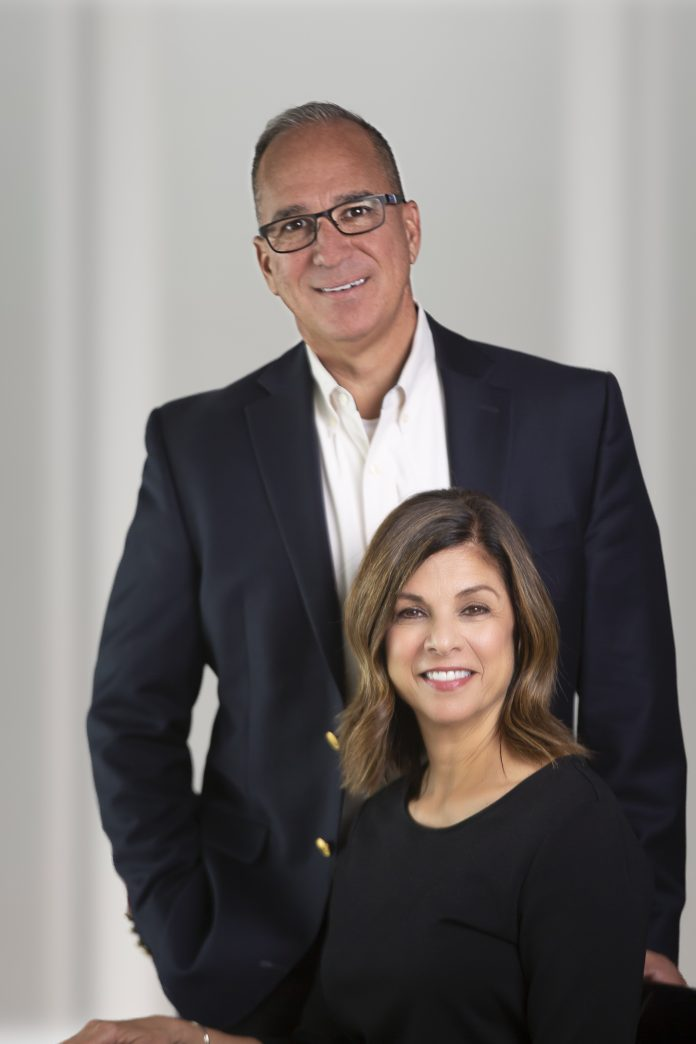 Joanne Powers, owner of Shear Art Salons & Spas and Summit Salon Academy, and Mike Mashke, Executive Vice President and Chief Lending Officer for First National Bank of Pasco.